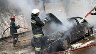 آتش سوزی پژو ۴۰۵ در میدان تسلیحات تهران