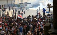 وزیر دفاع عراق: طرف سومی به سمت معترضان شلیک میکند