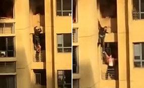 عملیات خطرناک دو شهروند چینی برای فرار از آپارتمان در حال سوختن + فیلم