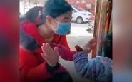 ملاقات پرستار چینی با فرزندش از پشت شیشه + فیلم